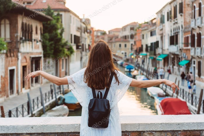 young girl walks the streets of Venice