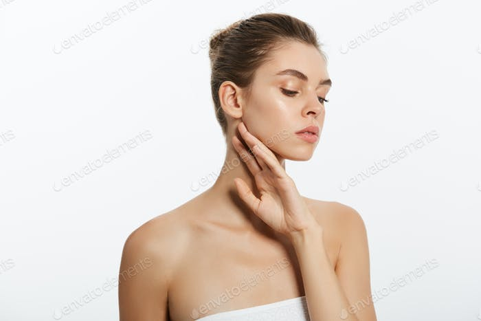 Beauty face of young woman. Skin care concept. Closeup portrait isolated on white