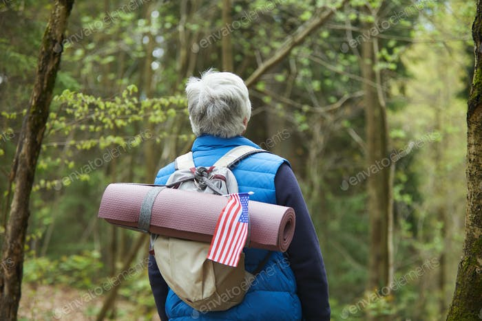 Senior Backpacker Hiking in Forest