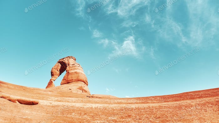 Retro stylized picture of Delicate Arch at sunset, USA.