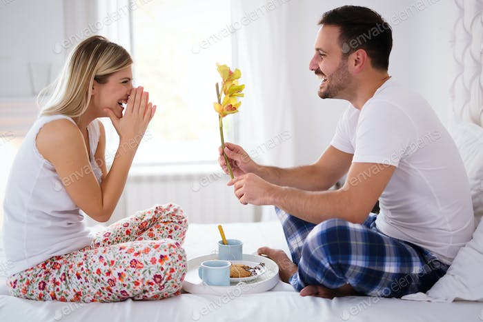 Surprise flower for woman in bed