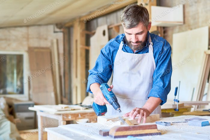 Bearded Carpenter Working in Joinery