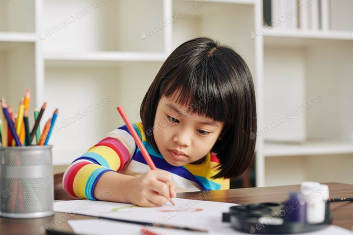 Serious drawing girl