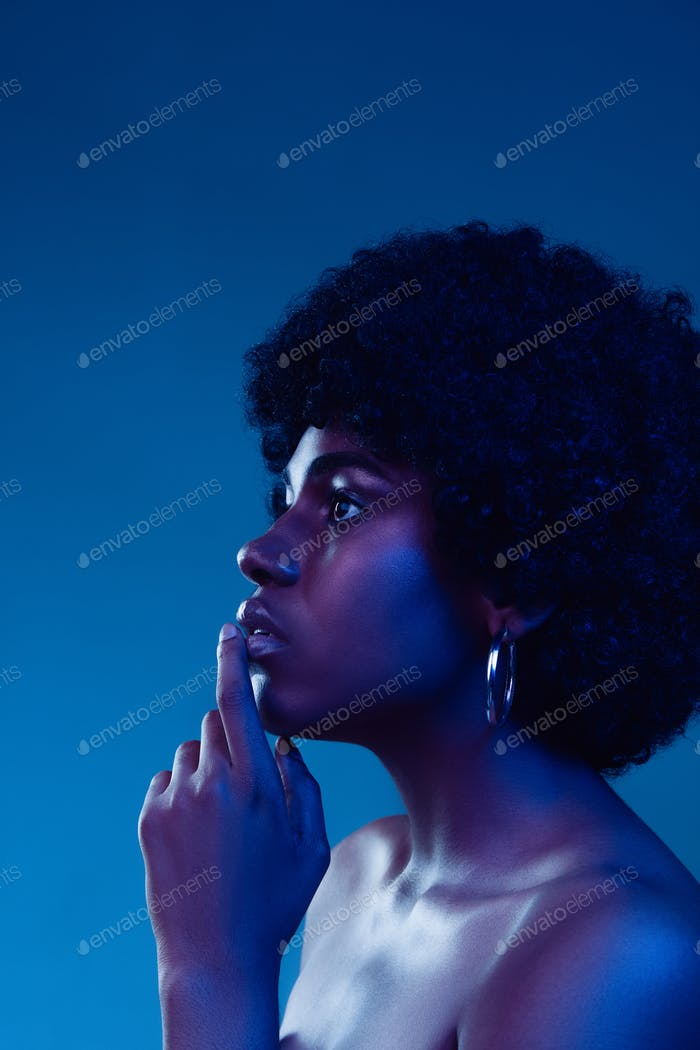Portrait of female high fashion model in neon light