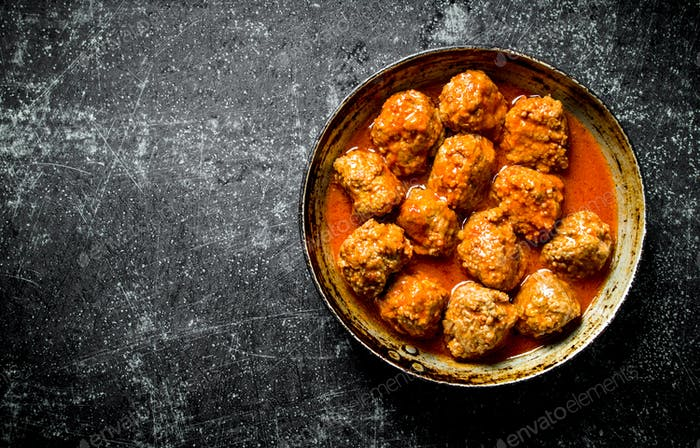 Meat balls in pan.