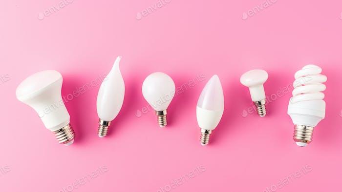 vista superior de varios tipos de lámparas en rosa, concepto de energía
