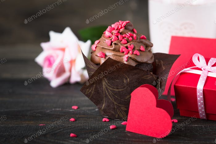 Chocolate cupcake with whipped cream for Valentine's Day
