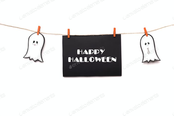 Happy halloween text hanging on the rope with two ghosts