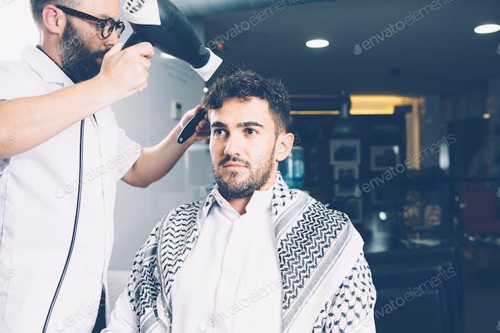Hairdresser applying drier