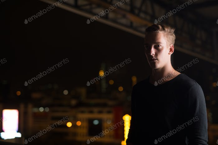 Young Handsome Man Outdoors At Night