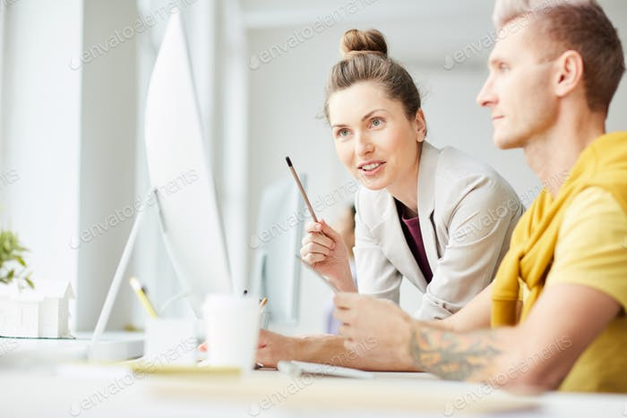 Business Manager Talking to Colleague