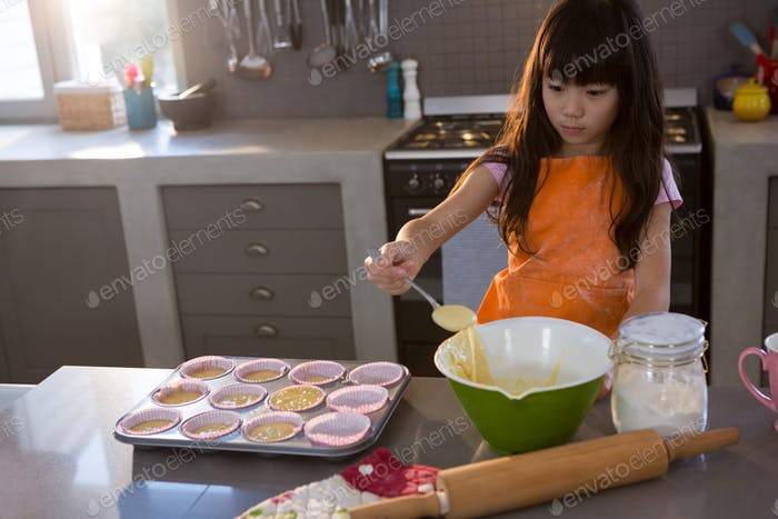 Girl mixing batter in bowl