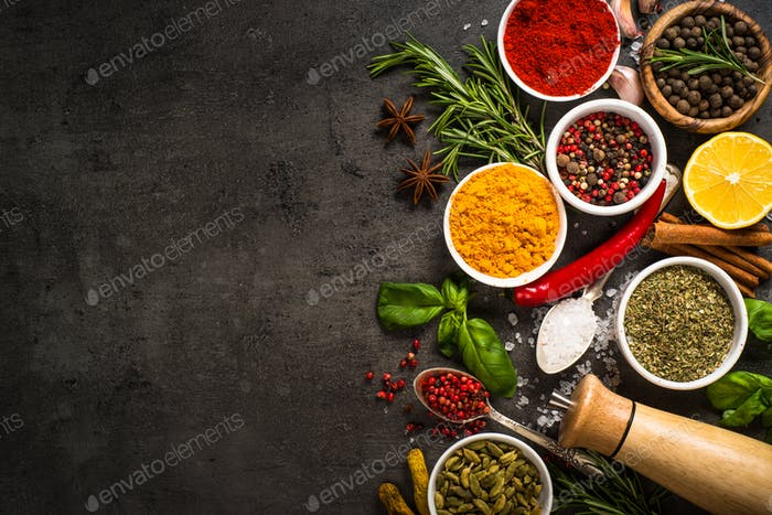 Set of various spices on black background