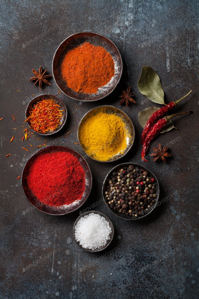 Colorful spices on stone table