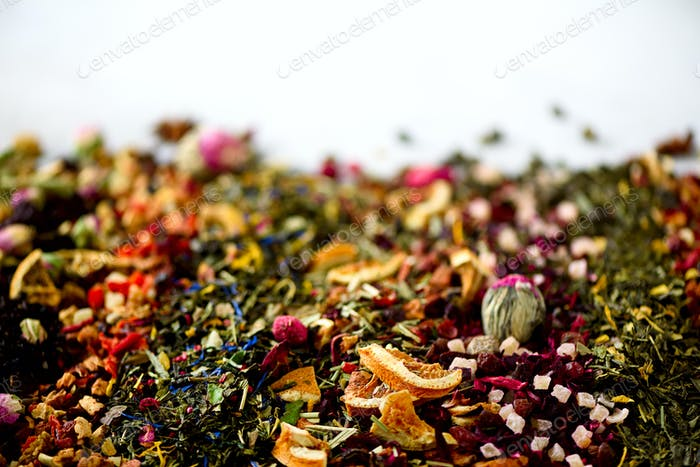 Close up tea background: green, black, floral, herbal, mint, melissa, ginger, apple, rose, lime tree