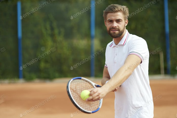 Tennis player with ball and racket