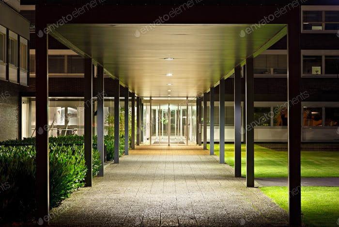 Roofed Office Building Entrance At Night