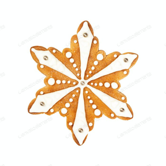 Traditional Christmas gingerbread in the shape of snowflake isolated on white background.
