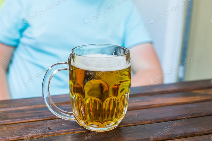 Drinks, alcohol, gesture and leisure concept - close up of man drinking beer