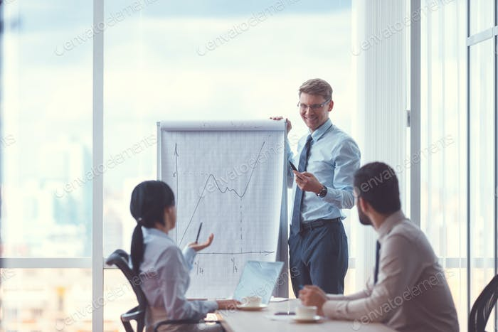 Smiling businessman with flipchart