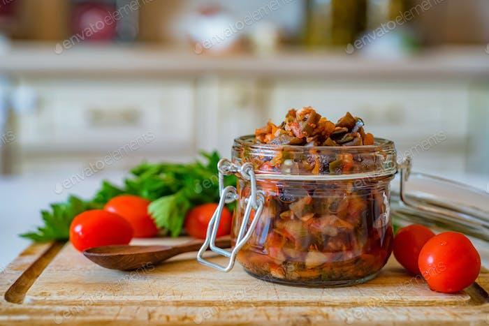 Close up home made aubergine pate or spread in jar