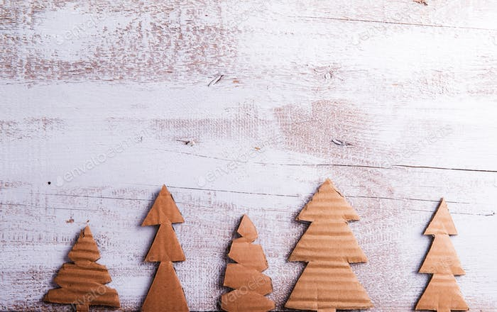 Carton trees on wooden background