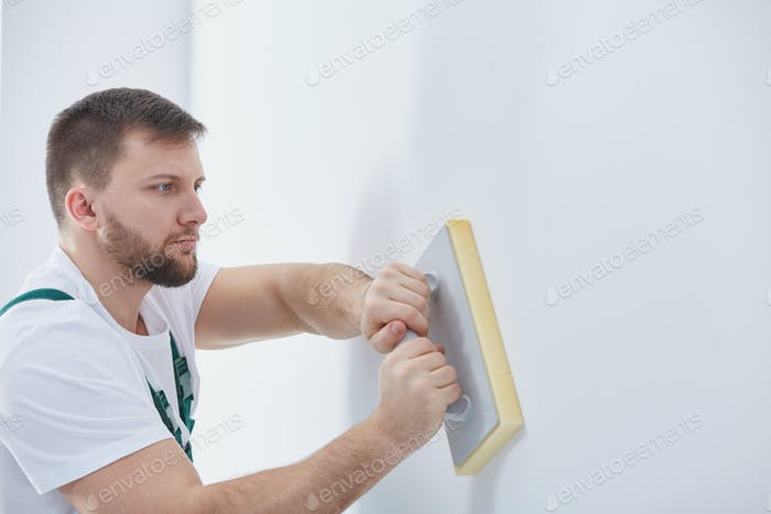 Rubbing down the wall