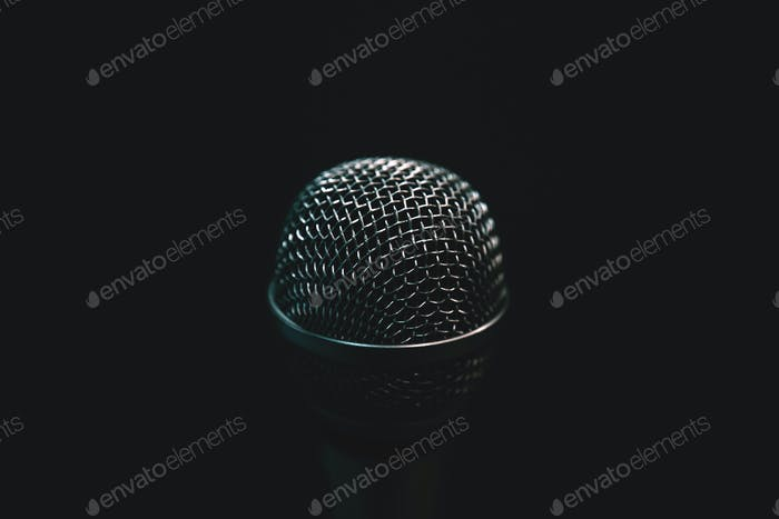 Audio microphone isolated on dark background