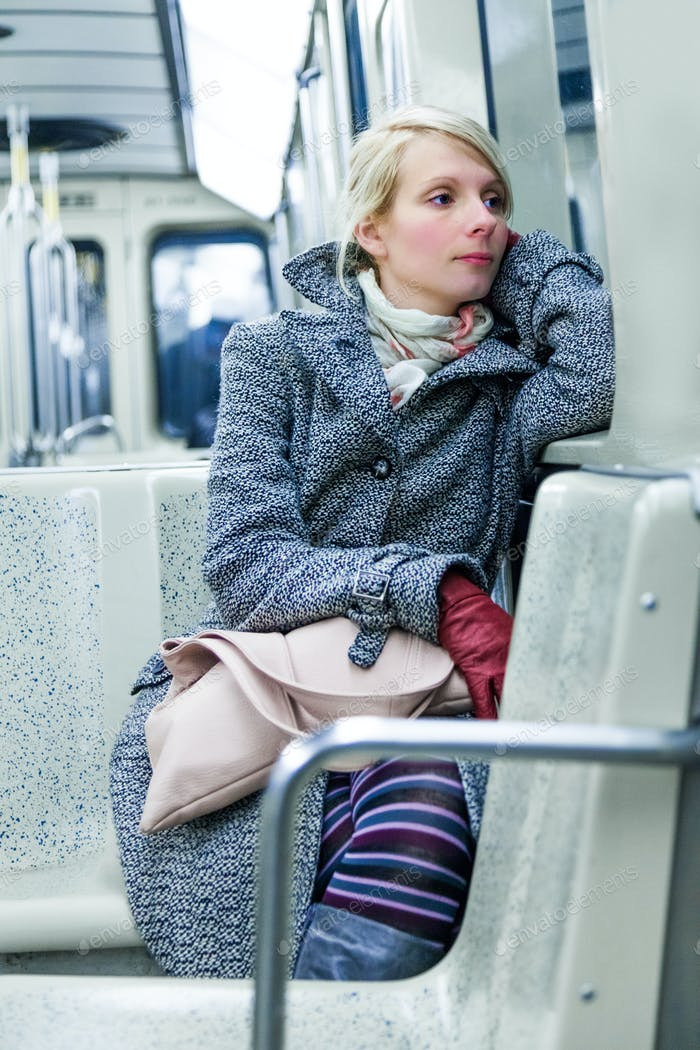 Young Woman Sitting inside a Metro Wagon