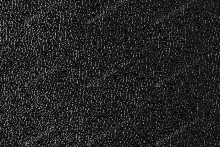 Schwarzer, strukturierter Hintergrund aus feinem Leder