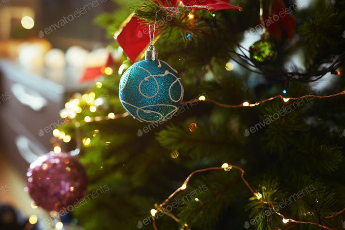 Decorated Christmas tree with light string. Close-up