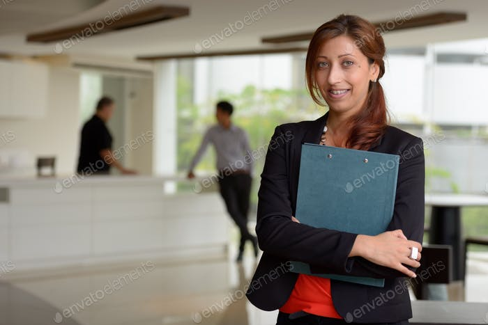 Hispanic businesswoman inside the office building