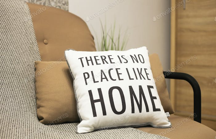 Cushions with a text There is no place like home. Stay home, quarantine concept.