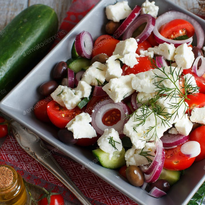 Greek salad and ingredients top view