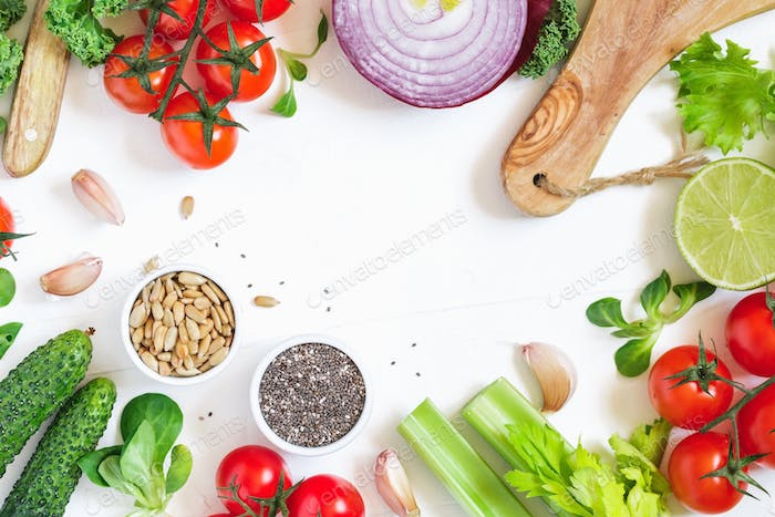 Top view of fresh vegetables over white background. Healthy and organic food frame. Flat lay.