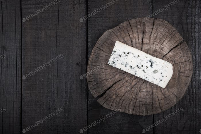 white cheese with green mold