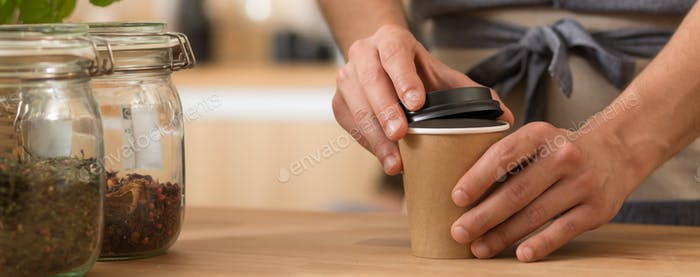 Barista preparing a takeaway coffee