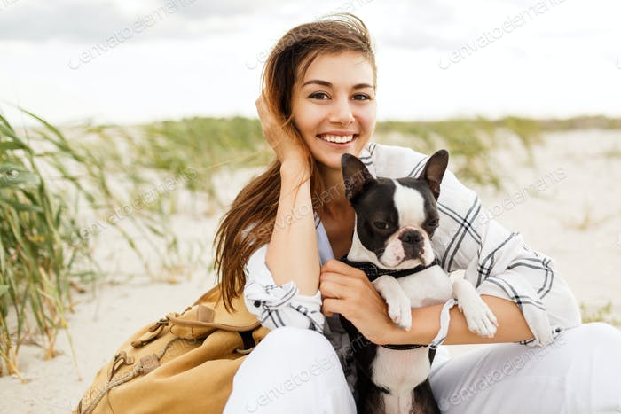 Cheerful woman with cute boston terrier dog