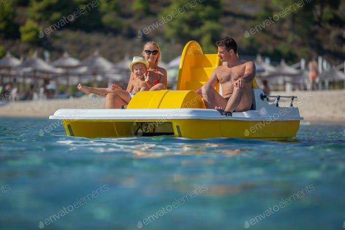 A family on a catamaran