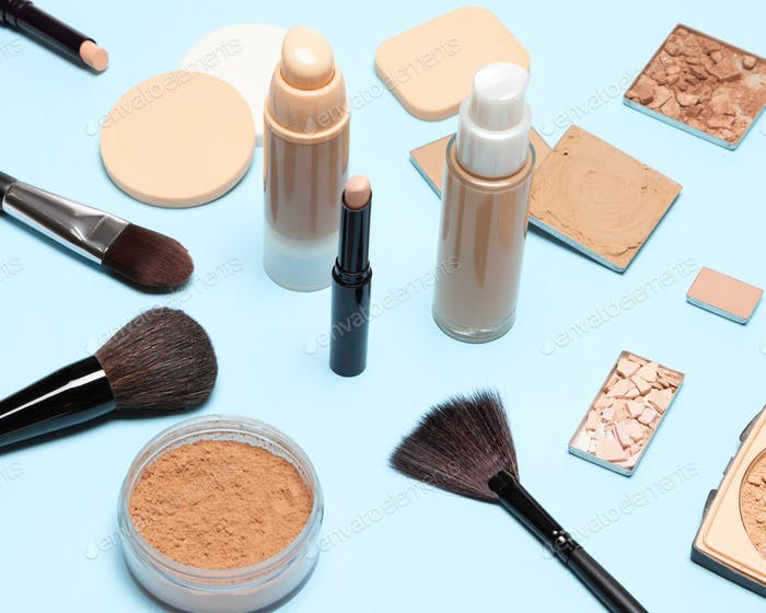 Make-up brushes and sponges with foundation makeup products