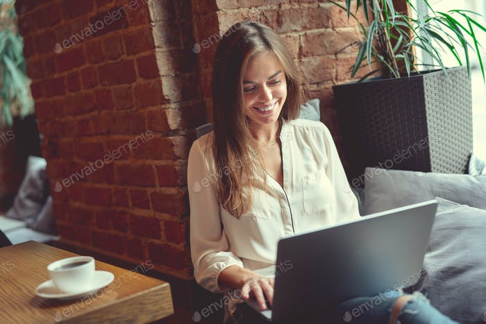 Smiling girl with laptop