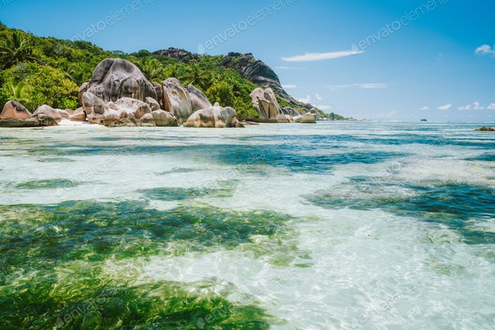 La Digue island, Seychelles. World famous paradise beach Anse Source d'Argent with shallow blue