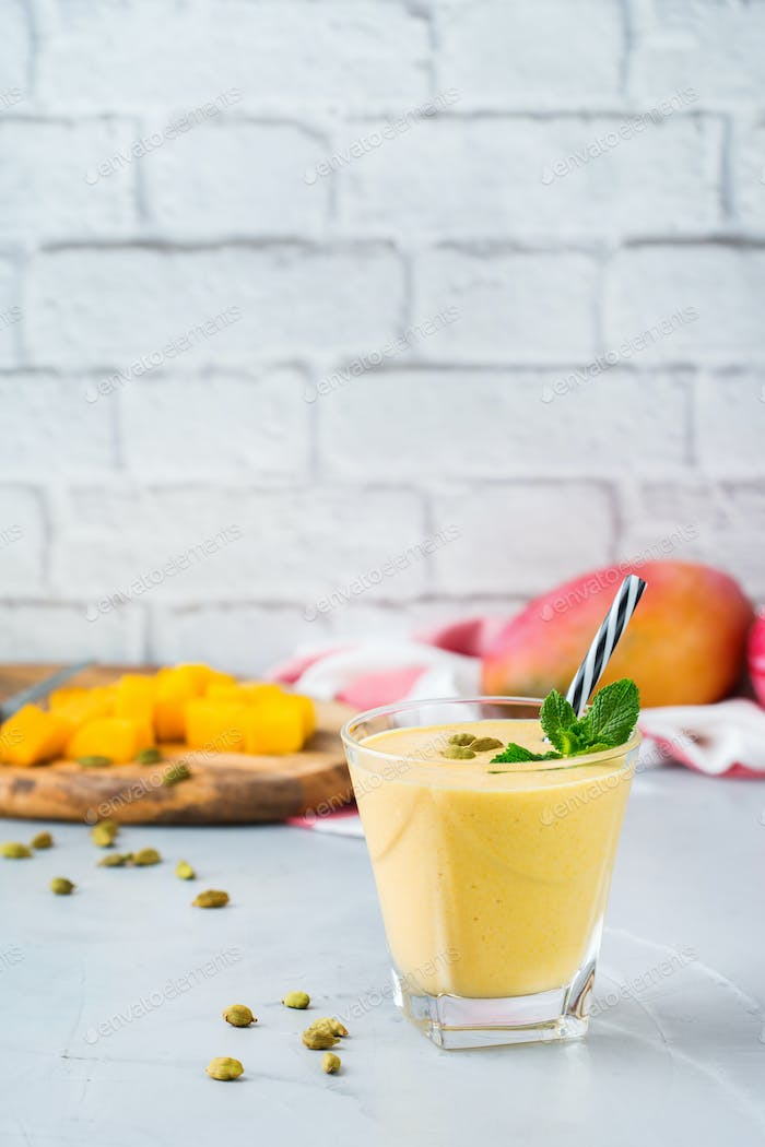 Mango lassi, indian drink, smoothie beverage with yogurt