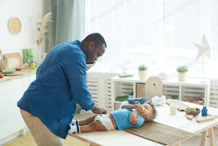 Father Trying to Change Diaper