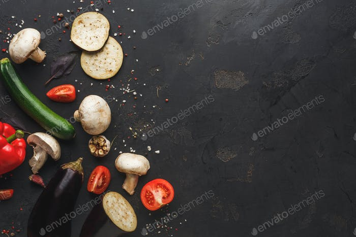 Vegetables on dark background top view copy space