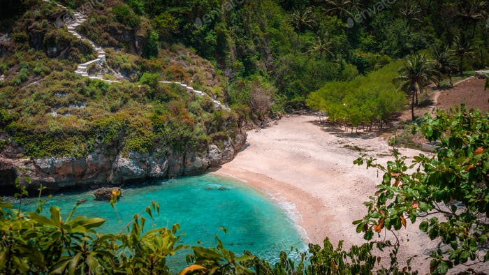 Lila Sunbed on Beautiful White Sand. Clear Blue Ocean, Atuh Beach, Nusa Penida, Bali, Indonesia