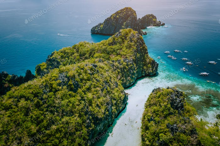 Aerial drone view of entrance to shallow tropical Big and Small Lagoon explored inside by tourist on