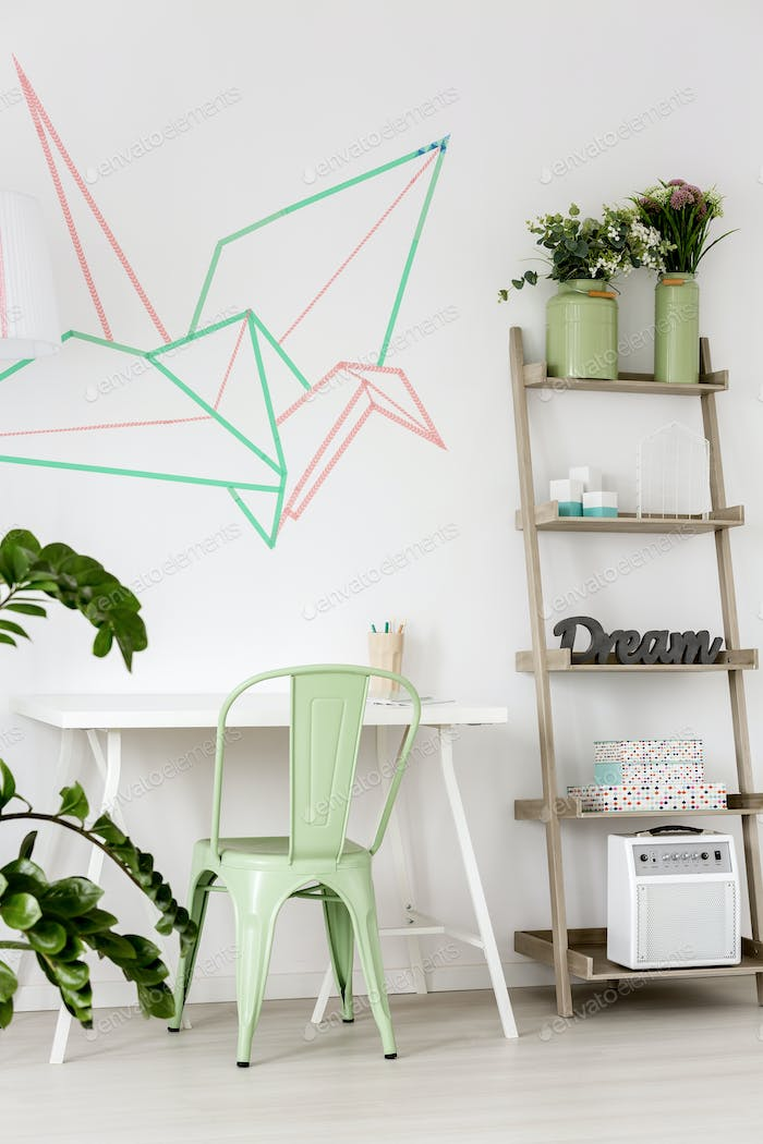 Room with mint chair and washi tape on the wall.