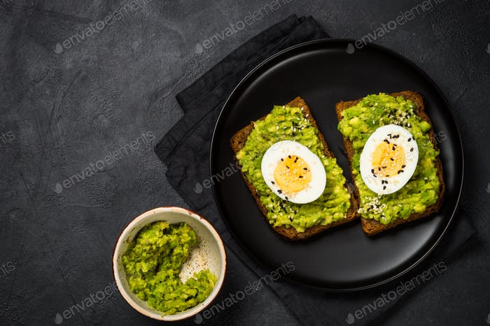 Avocado Sandwiches on black background
