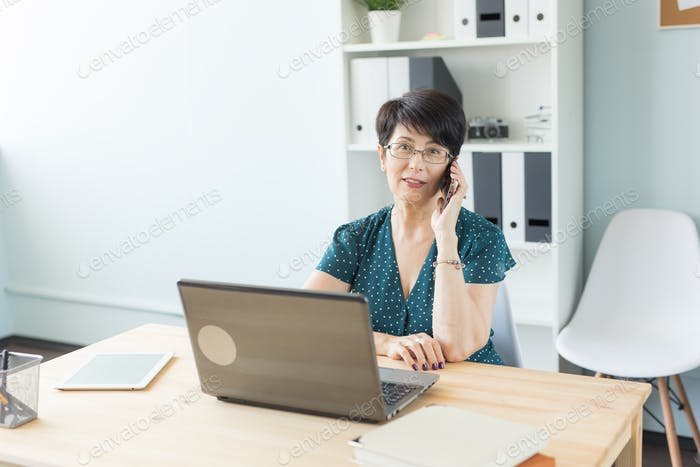 People, technology and communication concept - middle-aged woman calling on smartphone